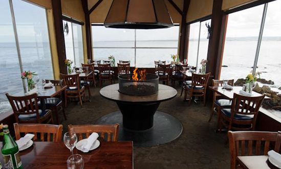 We Were Seated Near The Back End Of Restaurant And Had Windows On All Sides Us A 360 Water View Our Table Was Also An Indoor Fire Pit Which